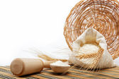 Flour and wheat grain with wooden spoon on a wooden table. — Stock Photo