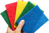 Female hand with colorful cleaning sponges, isolated on a white — Stock Photo