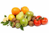 Fresh fruits and vegetables isolated on a white background. — Stock Photo
