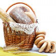 Fresh bread in the basket isolated. — Stock Photo