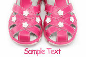 Pink child's sandals isolated on white — Stok fotoğraf