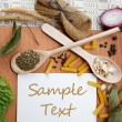 Notebook for recipes and spices on wooden table — Foto Stock #11820800