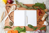 Notebook for recipes and spices on wooden board. — Stock Photo