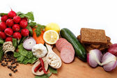 Healthy food. Fresh vegetables and fruits on a wooden board. — Stock Photo