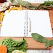 Notebook for recipes and spices on wooden table — Stock Photo #11933441