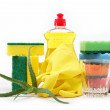 Detergent bottle, rubber gloves and cleaning sponge on a white b — Stock Photo #11940439