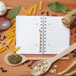 图库照片: Notebook for recipes and spices on wooden table