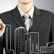 Royalty-Free Stock Photo: Business man draw building and cityscape