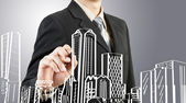 Business man draw building and cityscape — Stock Photo