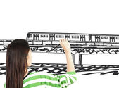 Woman draw train transportation and cityscape — Stock Photo