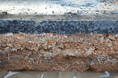 Layer soil beneath asphalt cement concrete — Stock Photo