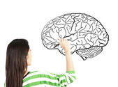Woman drawing human brain diagram — Stockfoto