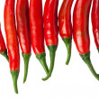 Red chili peppers isolated on the white — Stockfoto