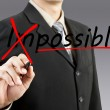 Motivation concept. Businessman changing the word impossible int — Stock Photo #12038406