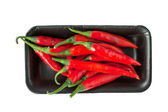 Red chili peppers in Styrofoam Food Tray — Stock Photo
