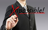 Motivation concept. Businessman changing the word impossible int — Stock Photo