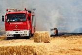 Firemen, truck hydraulic pumps, — Stock Photo