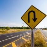 U-turn symbol Road in rustic city — Stock Photo