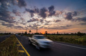 Road in rustic city motion car — Stock Photo