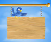 Blue bird on wooden sign — Stock Vector