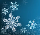 Blue Christmas snowflake background — Vector de stock