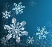 Modré pozadí vánoční vločka — Stock vektor