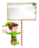 Christmas elf with sign — Stock Vector