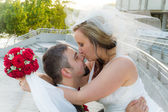 The bride kisses the groom — Stock Photo