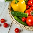 Fresh vegetables in a wicker basket — Stock Photo