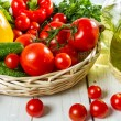 Stock Photo: Vegetables in basket and olive oil