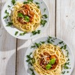 Spaghetti for two seasoned with fresh spices — Stock Photo