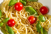 Close-up of pasta with tomato and basil — Stock Photo