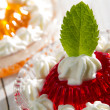 Red jelly with cream and mint leaf — Stock Photo