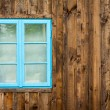 Old home with blue window background — Stock Photo