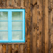 Old home with blue window background - Stock Photo