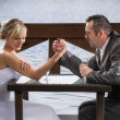 The bride wrestle on the hand of the groom — Stock Photo #11641964