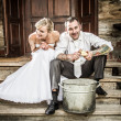 Happy young couple on the old porch — Stock Photo