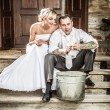 Young couple takes potatoes for wedding ceremonies — Stock Photo #11642772