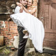 The groom brings the bride to the house — Stock Photo