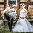 Royalty-Free Stock Photo: Young couple in front of old vintage house