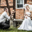 The groom shows off in front of a bride — Stock Photo