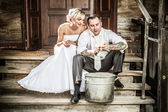 Young couple takes potatoes for wedding ceremonies — Stock Photo
