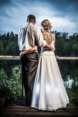 Young couple looking to the storm clouds — Stock Photo