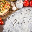 I love pizza written in flour — Stock Photo