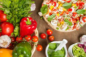 Pizza and fresh ingredients — Stock Photo