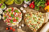 Baked heart-shaped pizza — Stock Photo