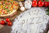 I love pizza written in flour — Stock Photo