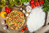 Freshly baked pizza and copy space for the menu on the flour — Stock Photo