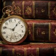 Old pocket watch and books in Low-key copy space — Stock Photo #11684348