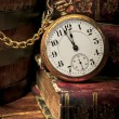 Old pocket watch and books in Low-key — Stock Photo #11684357